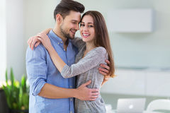 Couple embracing in kitchen Stock Image