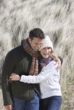Couple Embracing In Long Grass Stock Photos