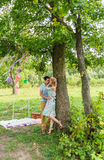 Couple embracing on nature. Young romantic man and woman standing and hugging each other with tenderness outdoors. Young Royalty Free Stock Photo