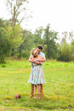 Couple embracing on nature. Young romantic man and woman standing and hugging each other with tenderness outdoors. Young Stock Photos