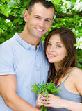 Couple embracing near flowered tree Royalty Free Stock Photos