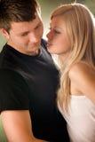 Couple embracing, outdoors Stock Photos