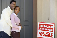 Couple Embracing Outside Their New House Royalty Free Stock Photos