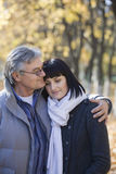 Couple Embracing In Park Stock Images