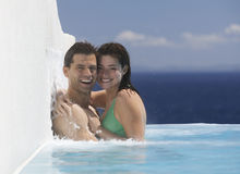 A couple embracing in a pool Stock Image