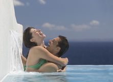 A couple embracing in a pool Royalty Free Stock Image
