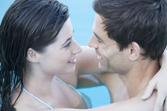 A couple embracing in a pool Royalty Free Stock Photos