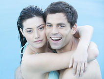 A couple embracing in a pool Stock Photo
