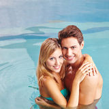Couple embracing in pool Stock Image