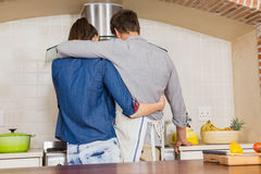 Couple embracing while preparing a meal Royalty Free Stock Photography