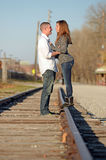 Couple Embracing On Raildroad Tracks Royalty Free Stock Image