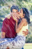 Couple embracing in the rain Stock Images