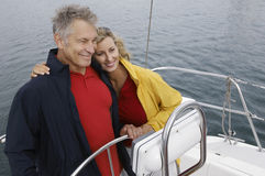 Couple Embracing On Sailboat Stock Images