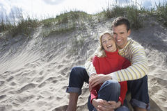 Couple Embracing On Sandy Beach Stock Photos