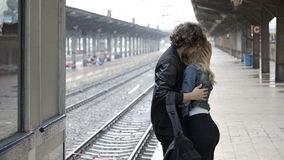 Couple embracing and saying goodbye before boyfriend getting on train to leaving stock video