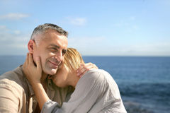 Couple embracing by the sea stock image