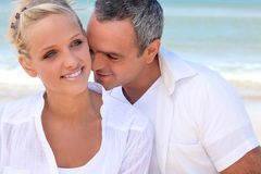 Couple embracing by the sea Royalty Free Stock Images