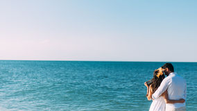 Couple embracing at sea Stock Photo