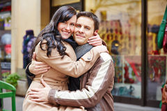 Couple embracing on shopping spree Stock Photo
