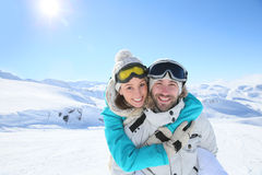 Couple embracing in snowy mountains Stock Image