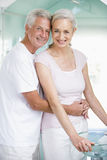 Couple embracing at a spa and smiling Royalty Free Stock Image