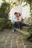 Couple Embracing On Steps Stock Photo