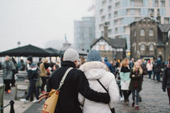 Couple embracing on street Stock Images