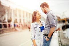 Cute couple enjoying time spent together outdoors stock images