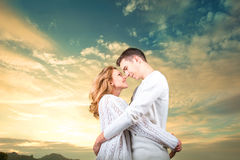 Couple embracing and watching one another under the sunny sky Royalty Free Stock Photos