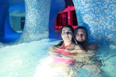 Couple embracing in water park. Portait of couple embracing in water park Royalty Free Stock Photography