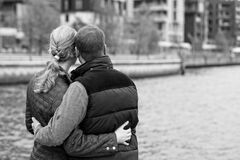 Couple embracing on waterfront