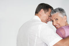 Couple Embracing On White Background Royalty Free Stock Images