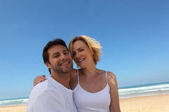 Couple on abeach. Couple on an empty beach Stock Photography