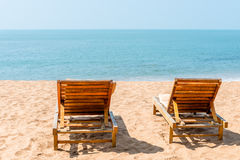 Couple of empty chairs on a sandy beach Stock Photography