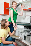 Couple emptying the dishwasher Royalty Free Stock Image