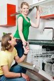Couple emptying the dishwasher Royalty Free Stock Image