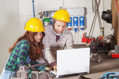 Couple of engineers consult the computer Stock Photos