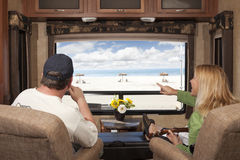 Couple Enjoy Beach View From RV. Young Couple Enjoying the Beach View From Their 5th Wheel RV Stock Photography