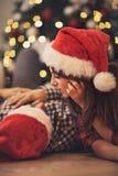 Couple enjoy at Christmas eve Stock Image