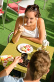 Couple enjoy coffee dessert restaurant terrace Royalty Free Stock Images