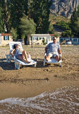Couple enjoy on deck chairs Stock Photos