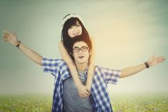 Couple enjoy freedom at field with instagram filter Royalty Free Stock Photography