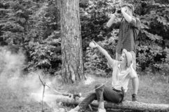 Couple enjoy hike in forest observing nature. Couple ornithologists expedition in forest. Woman and man looking. Couple enjoy hike in forest observing nature stock image