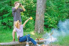 Couple enjoy hike in forest observing nature. Couple ornithologists expedition in forest. Woman and man looking. Couple enjoy hike in forest observing nature stock photography