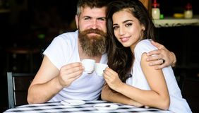 Couple enjoy hot espresso. Couple in love drink black espresso coffee in cafe. Romantic date in cafe. Pleasant coffee. Break. Drinking black coffee improves stock photography