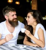 Couple enjoy hot espresso. Couple in love drink black espresso coffee in cafe. Romantic date in cafe. Drinking black. Coffee improves your mood and thus makes stock photos
