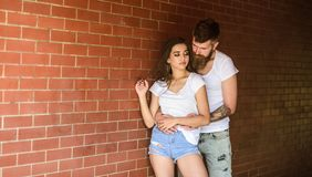 Couple enjoy intimacy cuddling without witnesses. Couple find place to be alone. Couple in love hugs brick wall. Background. He will never let her go. Girl and royalty free stock photo
