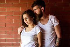 Couple enjoy intimacy cuddling without witnesses. Moments of intimacy. Couple find place to be alone. Couple in love. Hugs brick wall background. Girl and stock photo