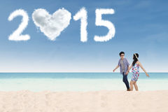Couple enjoy a new year holiday at beach Royalty Free Stock Photography