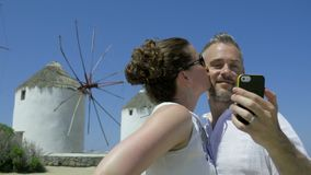 Couple enjoy a romantic holiday in greece. Scene of a couple enjoying a romantic holiday in Greece stock footage